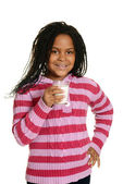 Little black girl with glass milk — Stock Photo