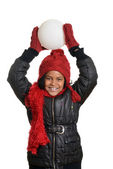 Little girl going to throw a snowball — Stock Photo