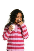 Young black child enjoying cupcake — Stock Photo