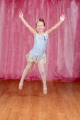 Little ballerina jumping in blue tutu — Stock Photo