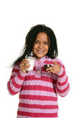 Little girl with milk and cupcake — Stock Photo