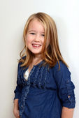 Happy little girl smiling — Stock Photo