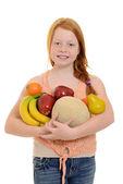 Little girl holding fruit — Stock Photo