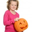 Happy little girl with pumpkin — Stock Photo #45779885