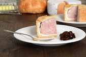 Slice pork pie with relish — Stock Photo