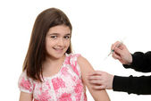 Happy child getting immunization injection — Stock Photo