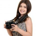 Little girl holding dslr camera — Stock Photo