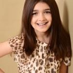 Happy little brunette girl — Стоковое фото #49890779