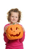 Little girl with carved halloween pumpkin — Stock Photo