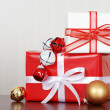 Pile of christmas gifts with bells — Stock Photo #7574212