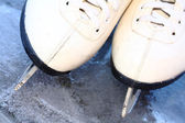 Skates on ice — Stock Photo
