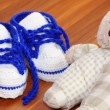 Stock Photo: Baby shoes and bear