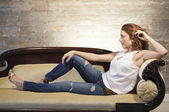 Attractive woman on the couch — Stock Photo