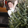 Decorating Christmas tree — Stock Photo #13366229