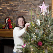 Stock Photo: Decorating Christmas tree