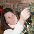 Decorating Christmas tree — Stock Photo #13544177