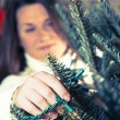 Decorating Christmas tree — Stock Photo #13544195