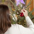 Decorating Christmas tree — Stock Photo #13544238