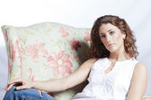 Attractive woman in the armchair — Stock Photo