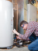 Water heater maintenance — Stock Photo