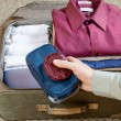 Packing suitcase — Stock Photo