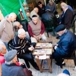 Men play backgammon game — Stock Photo