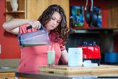 Woman pours diet shake — Stock Photo