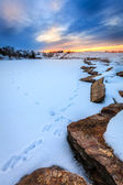 Sunset over a frozen lake — Stockfoto