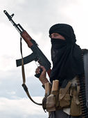 Muslim rebel with AK assault rifle — Stock Photo