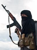 Muslim rebel with AK assault rifle — Stock Photo