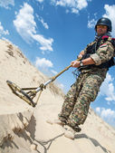 Soldier with metal detector — Stock Photo