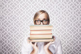 Woman Peering Over Books — Stock Photo
