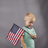 Young Boy Holds Flag on Shoulder — Стоковое фото