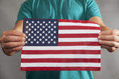 Two Hands Holding Flag — Stock Photo