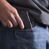 Concealing Firearm — Stock Photo