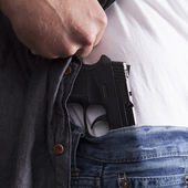 Revealing Concealed Firearm — Stock Photo