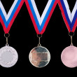 Three medals, Gold, Silver and bronze - Stock Photo