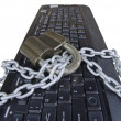 Computer  keyboard with chain and padlock — Photo