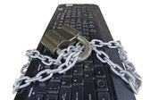Computer keyboard with chain and padlock — Stock Photo