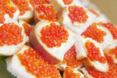 Red caviar on a plate — Stock Photo