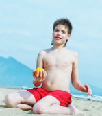Portrait of happy little boy on the beach — Stok fotoğraf