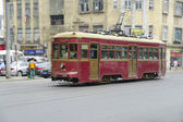 Dalian China - SEPT 2010 : ancient city tram on a street in motion — Stock Photo