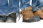 Two pairs of women's and men's shoes with tied laces — Stockfoto