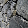 Wall of gray granite stones — Stock Photo