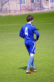 Soccer or football player on the field — Stock Photo