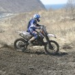 Stock Photo: Motocross bike in race