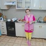 Senior woman in kitchen — Stock Photo