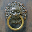Chinese lion doorhandle — Stock Photo #36436355