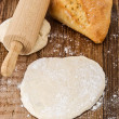 Dough on a wooden plate - Stock Photo