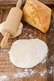 Dough on a wooden plate — Stock Photo